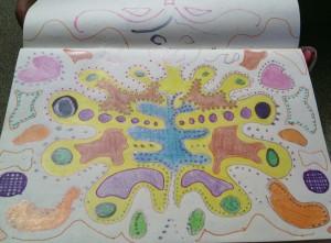 Colores y  papel en cuaderno